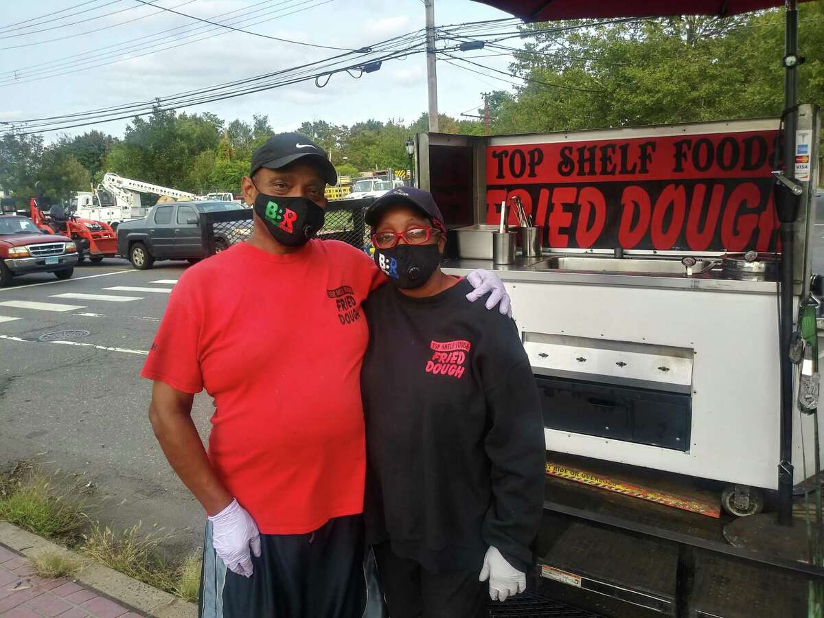 Clarence and Shantay Scott stand by their fried dough cart Wednesday on Dixwell Avenue in Hamden.
