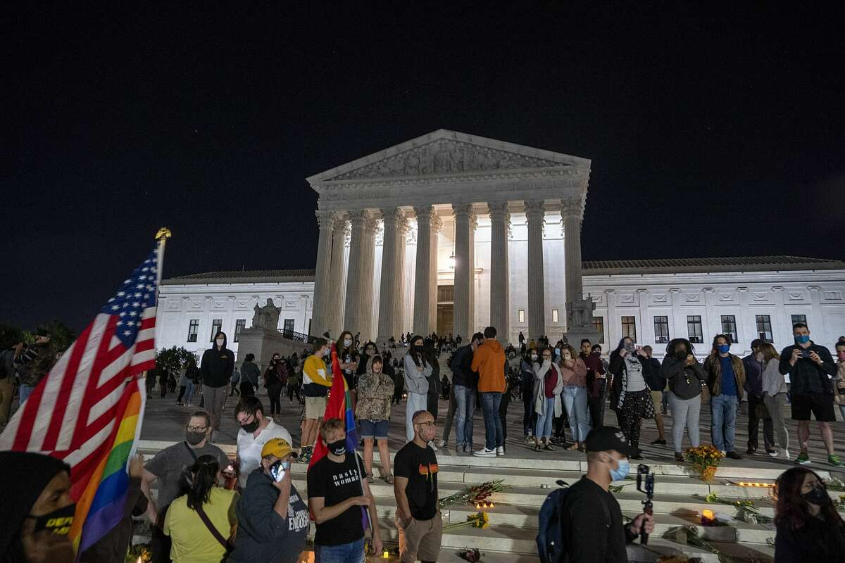 People gather to mourn the passing of Supreme Court Justice Ruth Bader Ginsburg at the steps in front of the Supreme Court on September 18, 2020 in Washington, DC. Ginsburg has died at age 87 after a battle with pancreatic cancer. (Photo by Tasos Katopodis/Getty Images)
