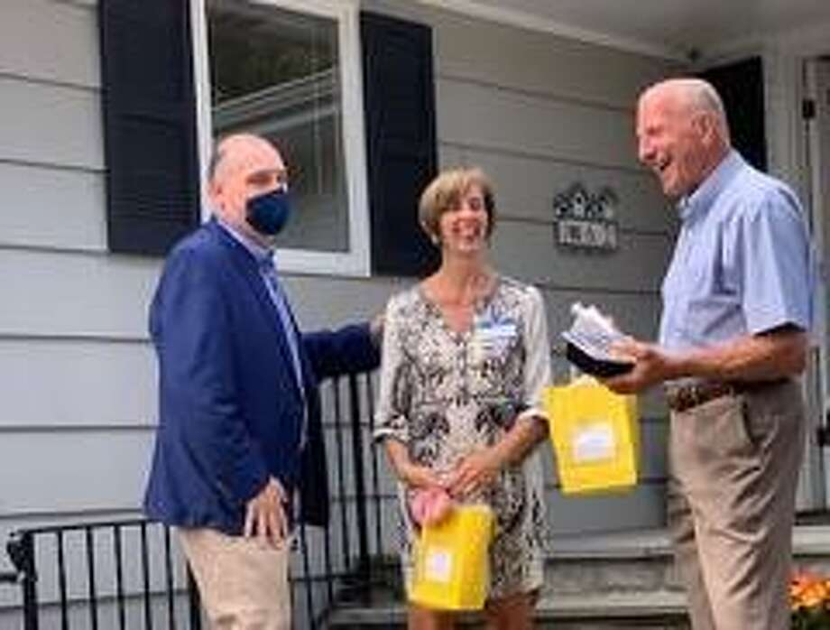 Business owner Deirdre Virvo with Chris Sinatra, left, of Higgins Group Realtor and Mayor Mark Lauretti at the grand opening of Just Like Home's Dogwood Home on Thursday, Sept. 11. Photo: Laura Abbott / Contributed Photo / Connecticut Post