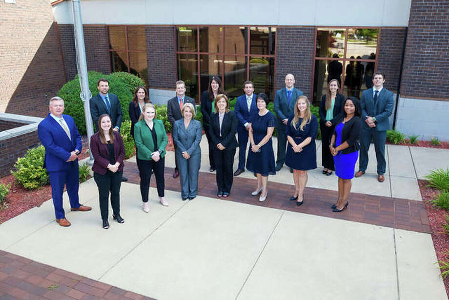Members of the Busey Wealth Management Metro East team are, in front from left, Chris Jordan, Alicia Strohmeier, Kelly Ruth Fuqua, Gail Washenko, Joann Barton, Lisa Hock, Mary Potthast and Marley Hitchye. In back, from left, are Bradley Sauer, Kathleen Vogt, Kevin Doak, Renea Harbert, Nick Suess, Michael Hungerford, Kim Haas and Will Rankin.