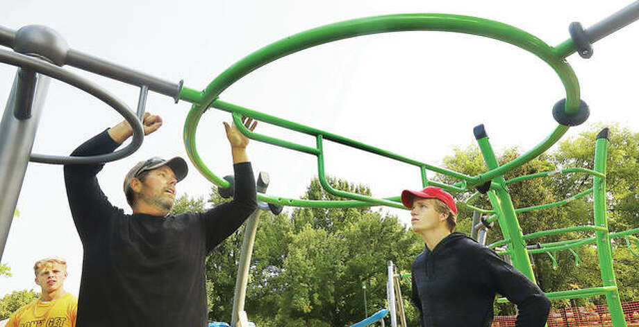 Roxana Park employees were banding together Friday to finish assembling and leveling of some new playground equipment in the village park which cost about $120,000 and was paid for with a grant.
