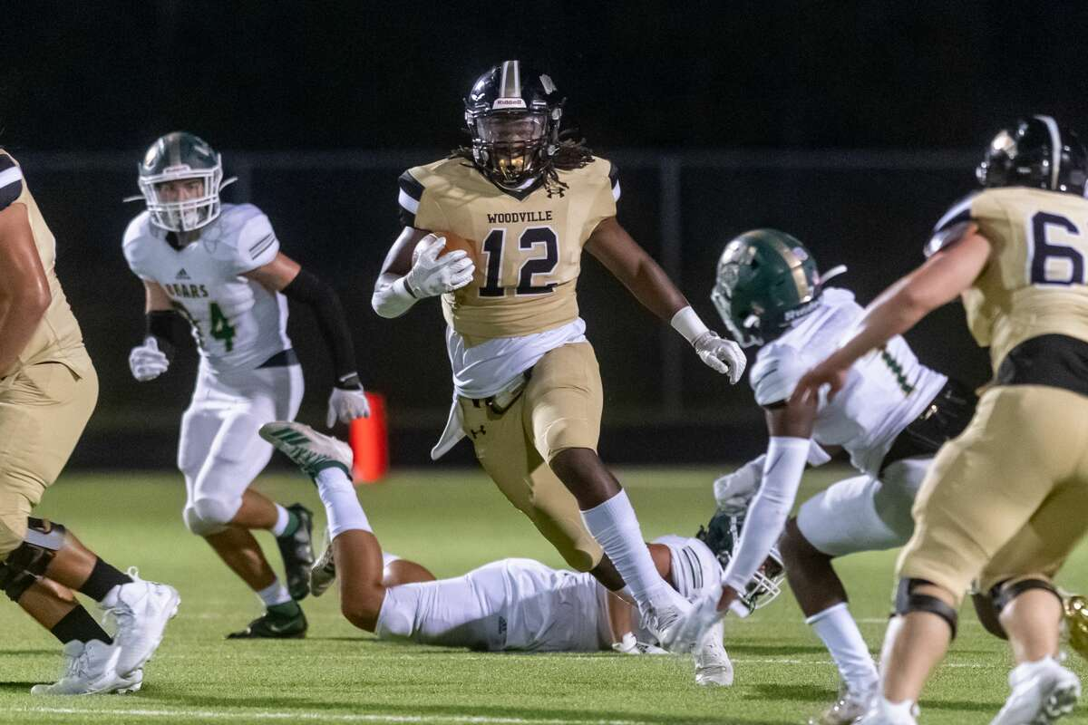 Woodville's Jacorey Hyder (12) carries the ball in the first half. The Woodville Eagles and the Little Cypress-Mauriceville Bears faced off on Friday night in Woodville with a final score of 14-6 with the home team taking the victory. Photo made on September 18, 2020. Fran Ruchalski/The Enterprise