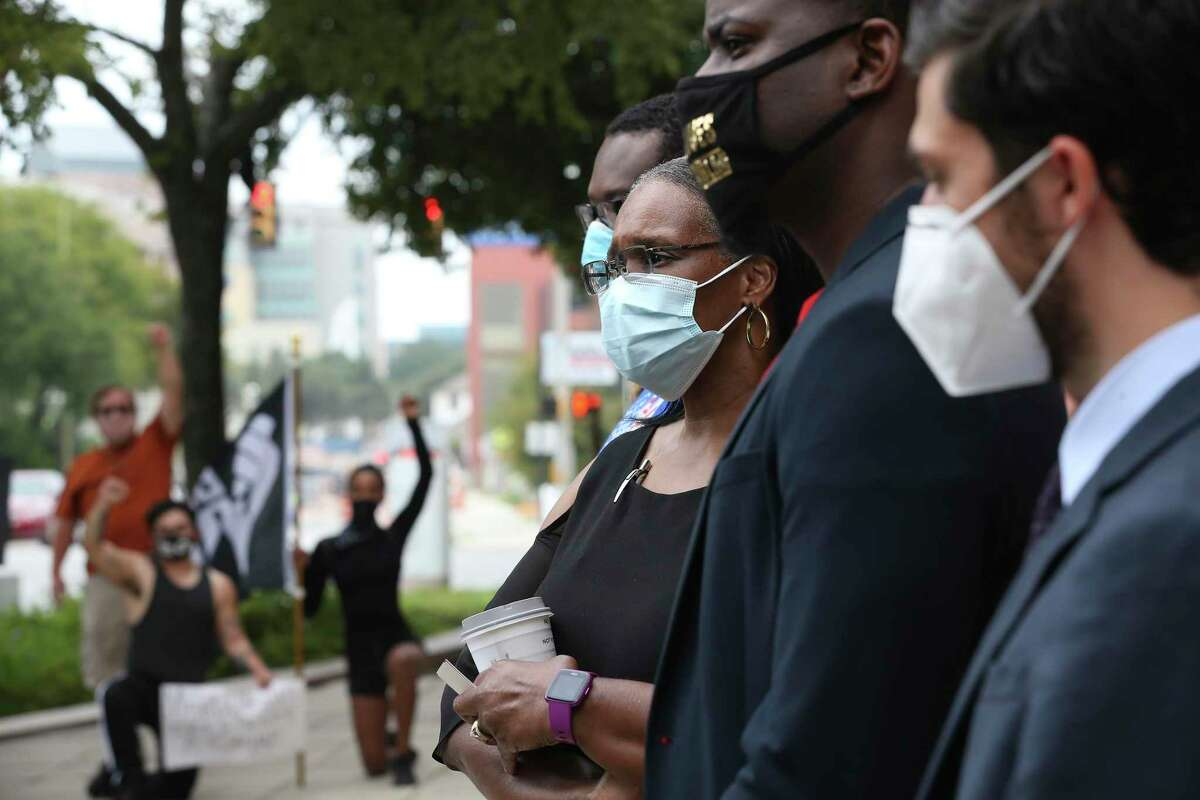 Annette Daniels, mother of Damian Lamar Daniels, listens during a press conference outside the DA's office.