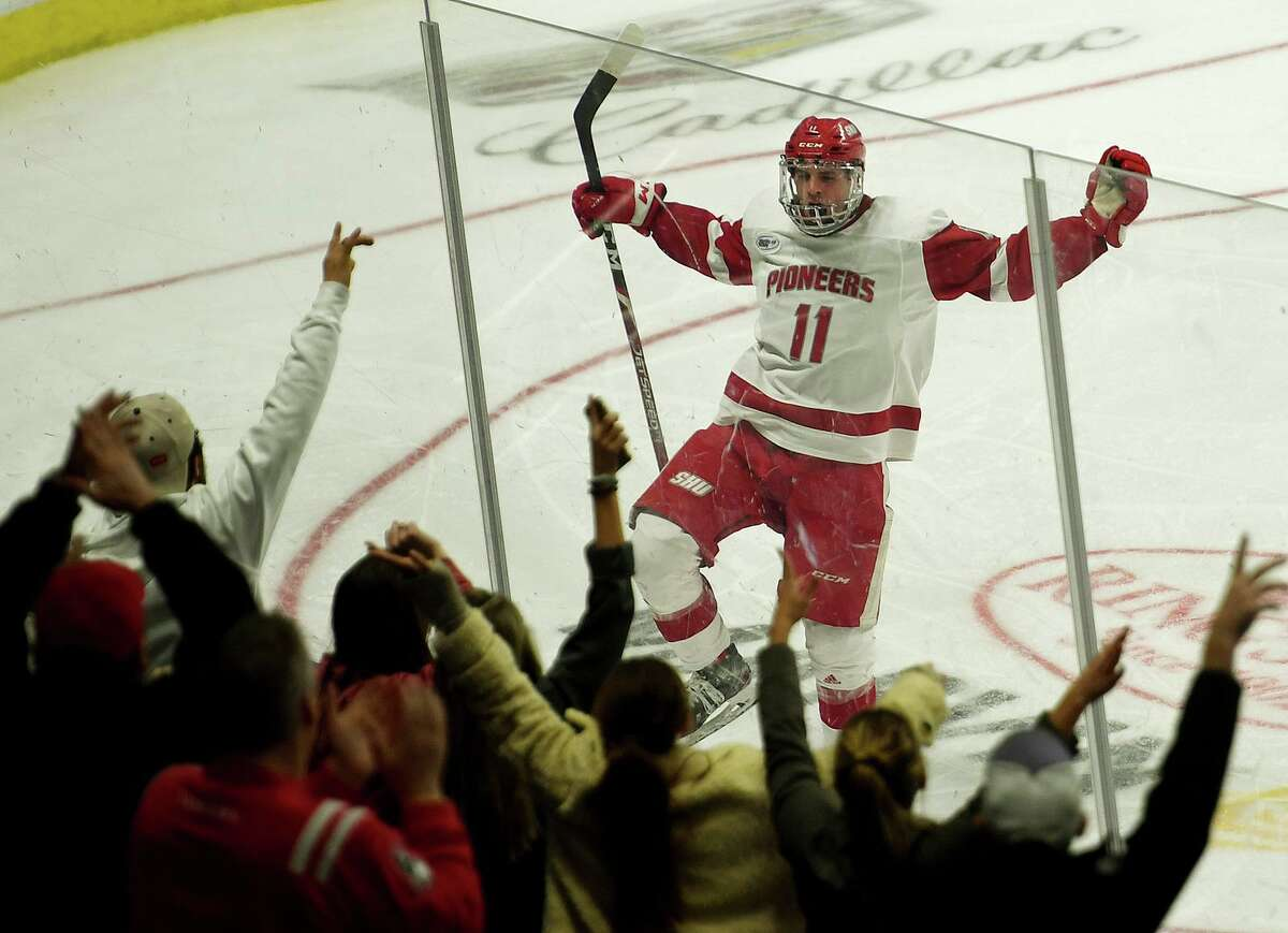 Sacred Heart's Ryan Steele celebrates with the fans after his team's first goal in a three goal second period in the championship game with Quinnipiac in the Connecticut Ice college hockey tournament at the Webster Bank Arena in Bridgeport, Conn. on Sunday January 26, 2020.