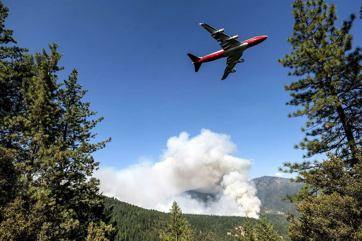 An air tanker prepares to drop retardant while battling the August Complex Fire, currently the largest in California history, burning in the Mendocino National Forest, Calif., Thursday, Sept. 17, 2020. (AP Photo/Noah Berger)