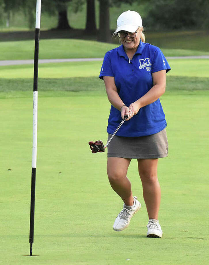 Marquette Catholic's Audrey Cain reacts after sinking an 8-foot putt for eagle on the par 5, hole No. 9 on Wednesday at Spencer T. Olin golf course in Alton. Photo: Matt Kamp / Hearst Illinois