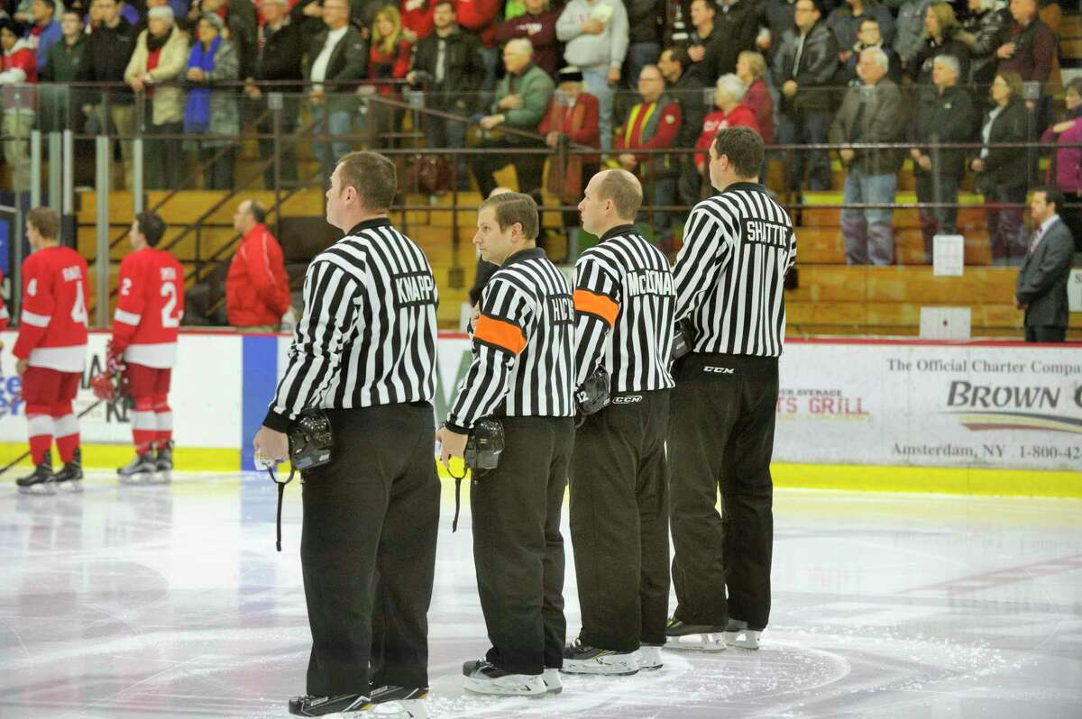 Orange native Bryan Hicks officiating a college hockey game.