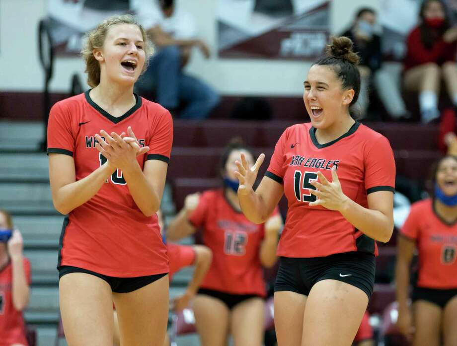 Oak Ridge right side hitter Tory Perduk (10) and setter Piper Boydstun (15) react after winning the fourth set of a non-district volleyball match at Magnolia High School, Saturday, Sept. 19, 2020. Photo: Gustavo Huerta, Houston Chronicle / Staff Photographer / 2020 © Houston Chronicle