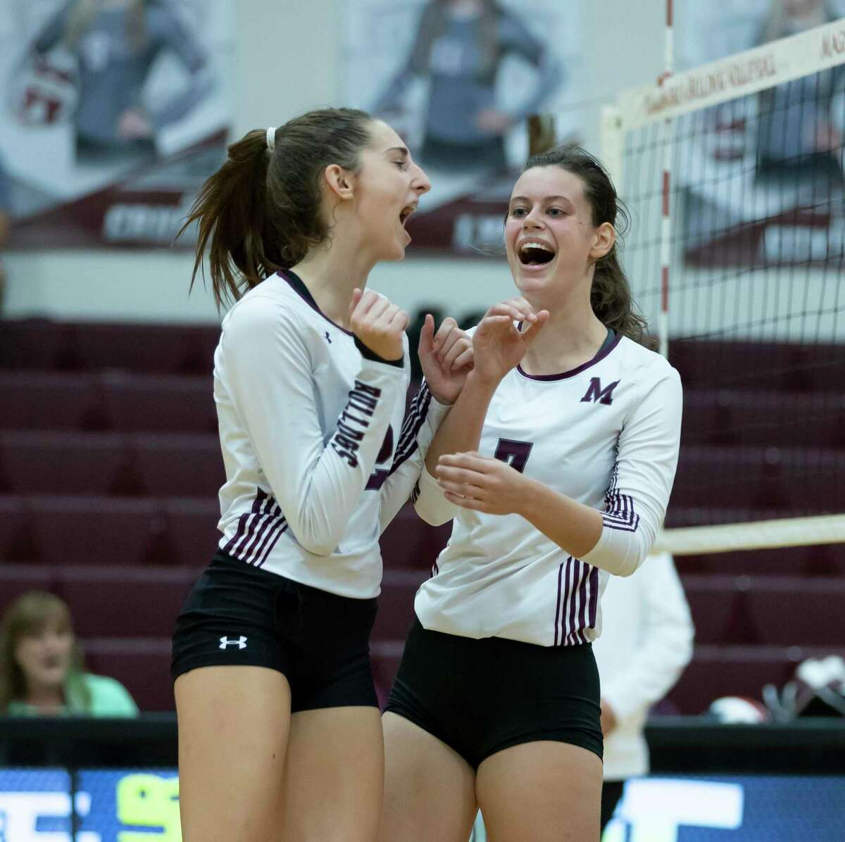 Magnolia setter Chloe Richards (2) and opposite hitter Marissa Moffatt (7) cheer after they score during the second set of a non-district volleyball match against Oak Ridge at Magnolia High School, Saturday, Sept. 19, 2020.