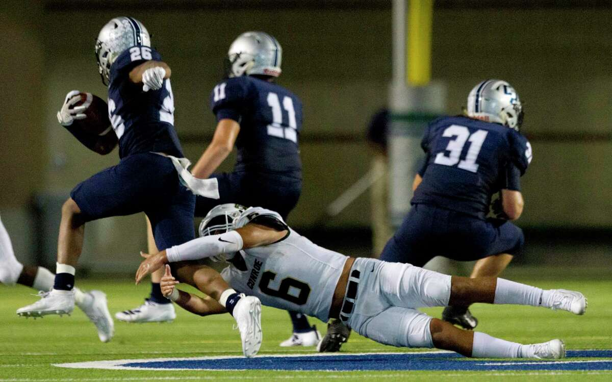 Conroe defensive back Layne O'Dell (6), pictured here tackling College Park's QuaJon Charles last season, is one of five returning starters on defense for the Tigers.