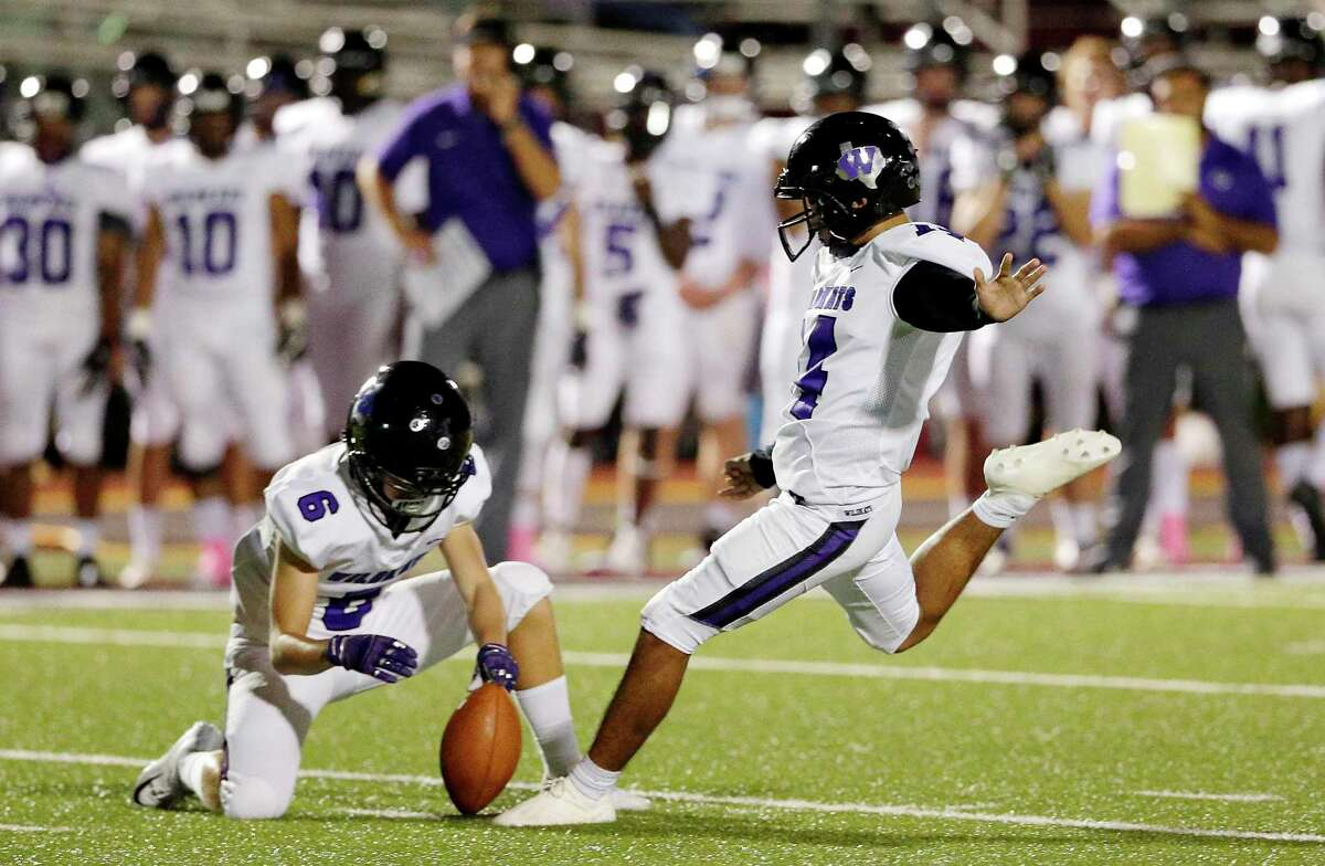 Willis' Garrett Collum holds the ball for kicker Christian Pavon as he makes a three point field goal against Magnolia during the first half of their game Friday, Oct. 12, 2018 in Magnolia, TX.