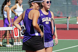 Civic Memorial's No. 1 doubles team Kennedy Loewen (right) and Hannah Butkovich share a laugh with coach Matt Carmody (not pictured) on Saturday morning during a break in play after taking a 3-0 lead in their match with Collinsville in Alton's Robert Logan Invitational girls tennis tournament in Troy. The eight-team tourney was played on courts at Alton and Triad high schools. Triad defeated Jersey in the championship match.