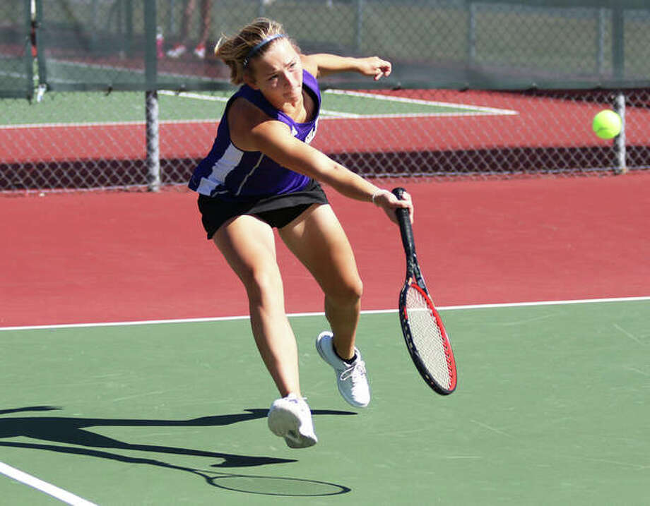 CM junior Allie Lively extends to return a shot during a singles match against Collinsville during Alton's Robert Logan Invitational girls tennis tournament Saturday morning in Troy. The eight-team tourney was played at courts at Alton and Triad high schools, Gordon Moore Park and Tri-Township Park in Troy. Photo: Greg Shashack | The Telegraph
