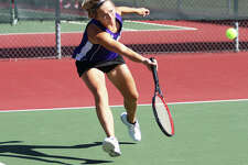 CM junior Allie Lively extends to return a shot during a singles match against Collinsville during Alton's Robert Logan Invitational girls tennis tournament Saturday morning in Troy. The eight-team tourney was played at courts at Alton and Triad high schools, Gordon Moore Park and Tri-Township Park in Troy.