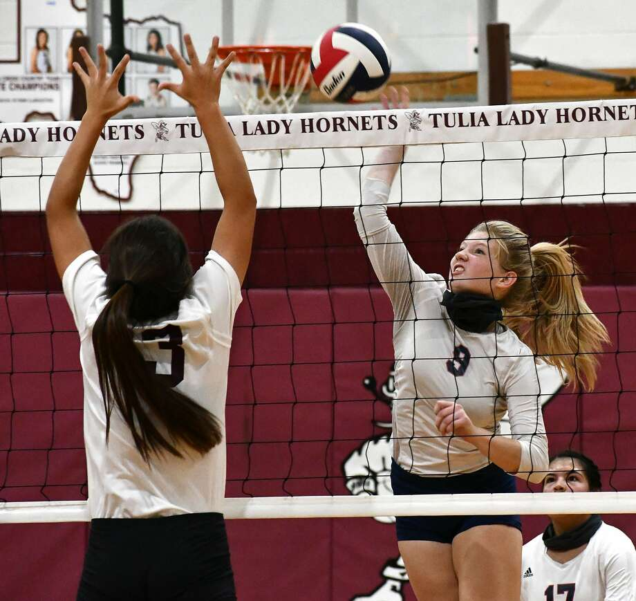 Plainview's Haley Curtis powers a kill past Tulia defender Allie Ramirez during their non-district high school volleyball match on Saturday, Sept. 19, 2020 in Tulia. Photo: Nathan Giese/Planview Herald