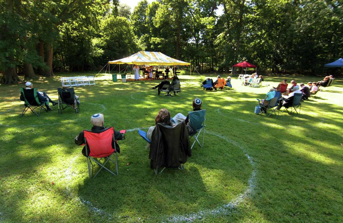 Temple Sholom holds an outdoor Rosh Hashanah service at The Meadow at St. Paul's Episcopal Church in Greenwich, Conn., on Saturday Sept. 19, 2020.