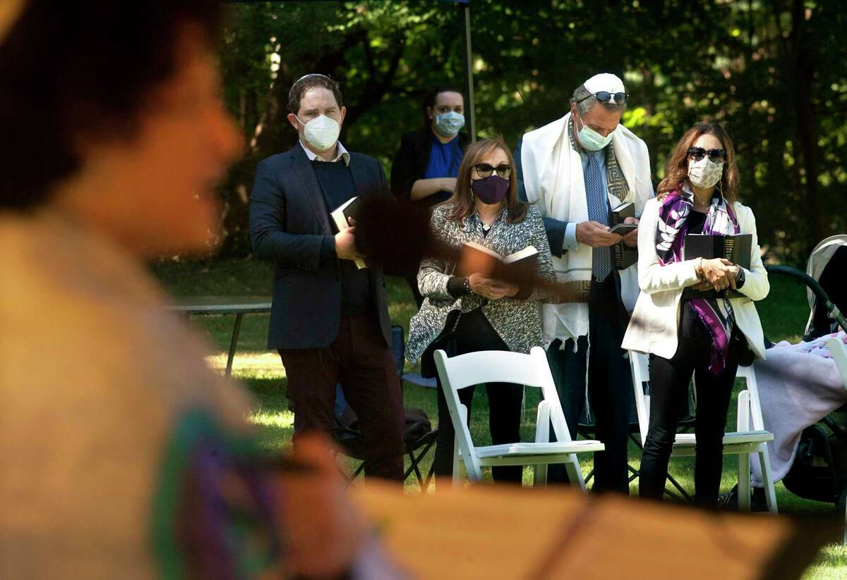 Temple Sholom, of Greenwich, holds an outdoor Rosh Hashanah service at The Meadow at St. Paul's Episcopal Church in Greenwich, Conn., on Saturday Sept. 19, 2020.