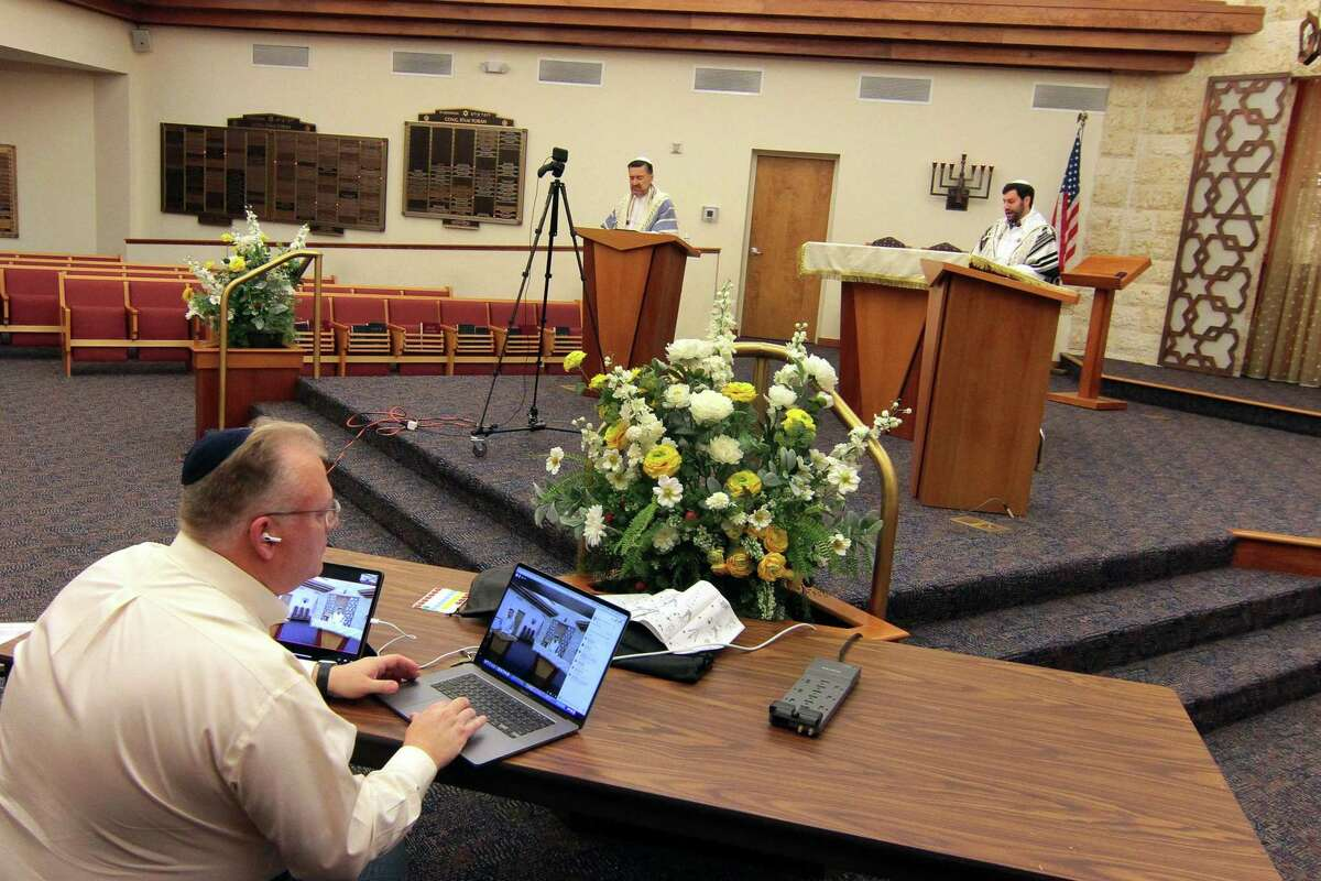 Because of the ongoing coronavirus pandemic, Fred Knopf runs Congregation B'nai Torah's Rosh Hashanah holiday service via livestream in Trumbull, Conn., on Friday Sept. 18, 2020.