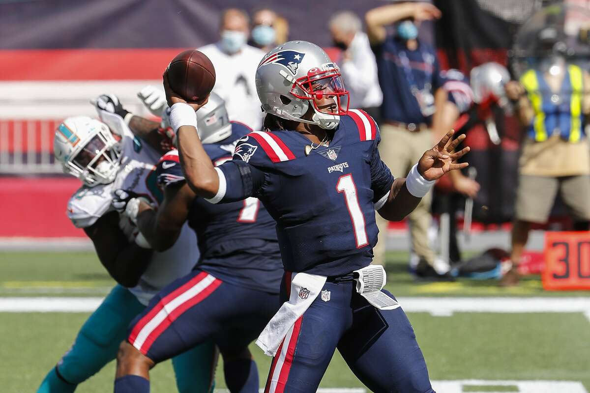 New England Patriots quarterback Cam Newton throws against the Miami Dolphins during an NFL football game at Gillette Stadium, Sunday, Sept. 13, 2020 in Foxborough, Mass. (Winslow Townson/AP Images for Panini)