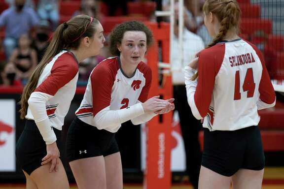 Shown here in a match earlier this month, Splendora setter Falton Buford (2), middle blocker Jalynn Knight (14) and Melaney Owens (5) all played key roles in defeating Conroe Saturday morning.