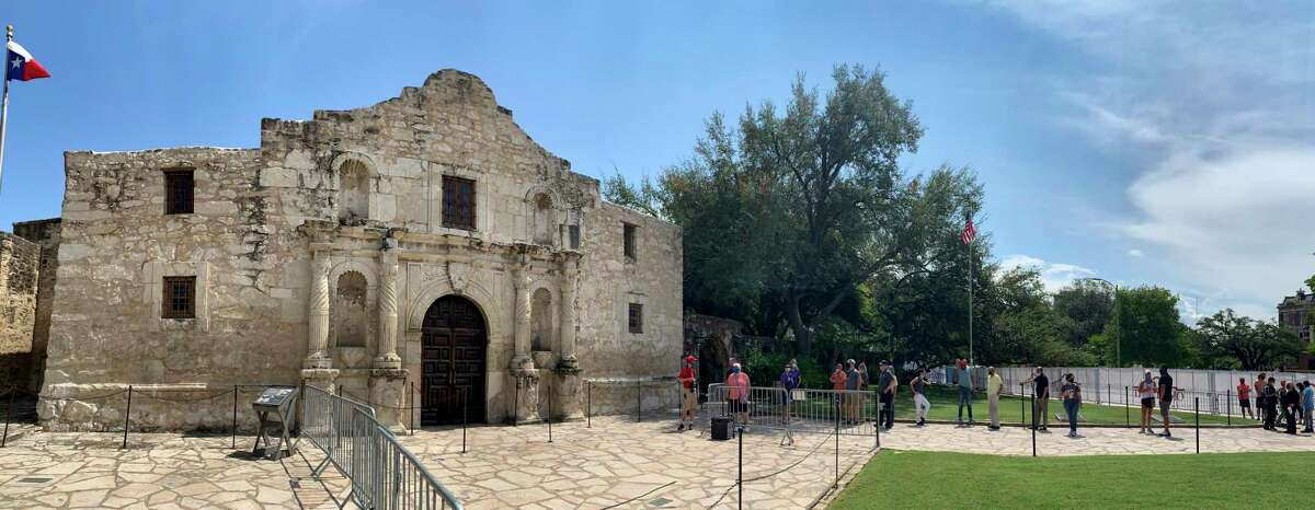 People stand in line to enter the Alamo shrine in this panoramic photo on Thursday, Sept. 17, 2020.