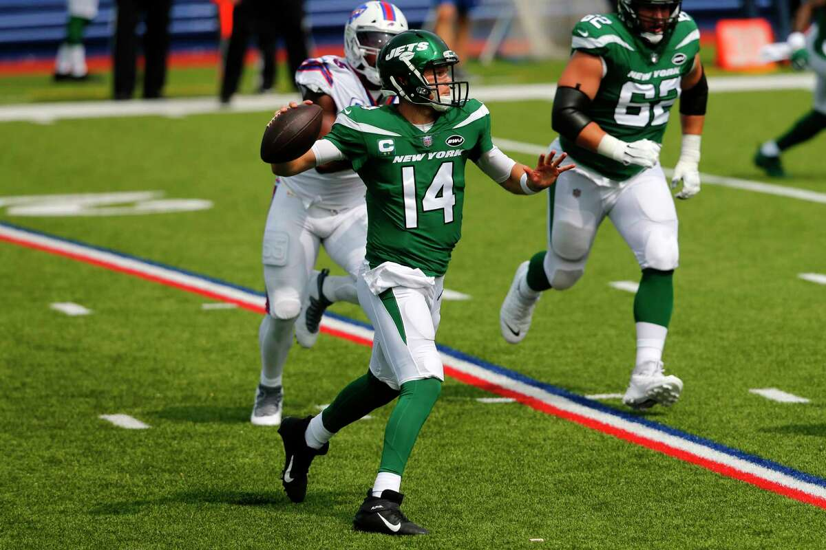 New York Jets quarterback Sam Darnold (14) looks to throw a pass during the first half of an NFL football game against the Buffalo Bills in Orchard Park, N.Y., Sunday, Sept. 13, 2020. (AP Photo/Jeffrey T. Barnes)