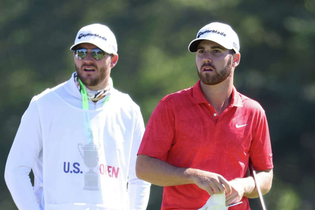MAMARONECK, NEW YORK - SEPTEMBER 19: Matthew Wolff of the United States prepares to hit off the first tee with caddie Nick Heinen during the third round of the 120th U.S. Open Championship on September 19, 2020 at Winged Foot Golf Club in Mamaroneck, New York. (Photo by Jamie Squire/Getty Images)