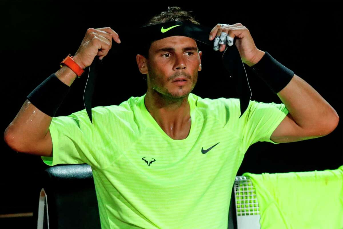 Spain's Rafael Nadal adjusts his headband during a change over of his quarter final match of the Men's Italian Open against Argentina's Diego Schwartzman at Foro Italico on September 19, 2020 in Rome, Italy. (Photo by Clive Brunskill / POOL / AFP) (Photo by CLIVE BRUNSKILL/POOL/AFP via Getty Images)