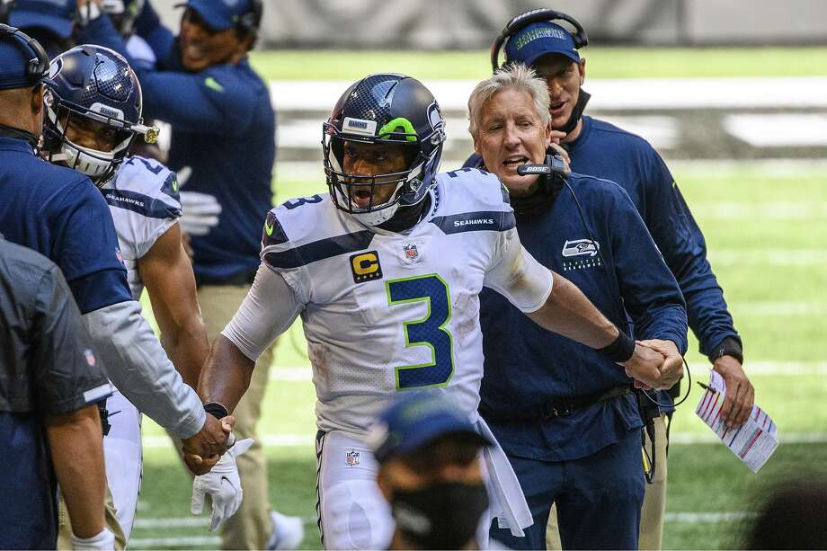 Seahawks quarterback Russell Wilson was named NFC Offensive Player of the Month for September, the league announced Thursday, the first time in his career winning the honor. It comes a day after he claimed the conference's offensive player of the week award for the second time in the first three weeks of the season. Photo: Danny Karnik, Associated Press
