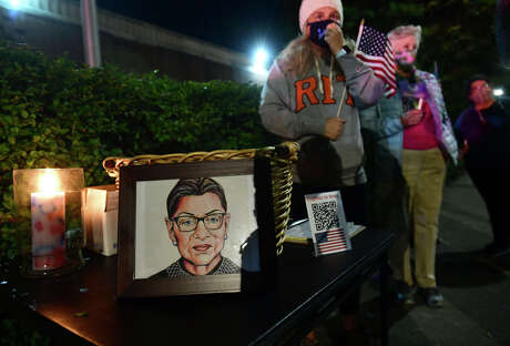 Supporters of Supreme Court Justice Ruth Bader Ginsberg gather outside Norwalk Superior Court Saturday, September 19, 2020, to honor her life and legacy in Norwalk, Conn. Ginsberg died Friday which opens up a a vacancy on the court.