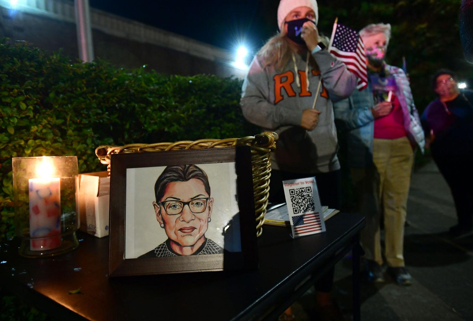 'Find that fire again,' candlelight RGB vigil attendees told