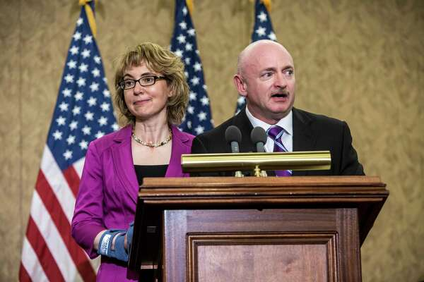 Gabrielle Giffords, the Arizona congresswoman who was critically injured in a 2011 shooting, and her husband, Mark Kelly, at a dedication ceremony to honor one of her staff members, Gabriel Zimmerman, who was killed in the 2011 shooting, in Washington, April 16, 2013. Giffords came to the Capitol Tuesday for a series of meetings with senators to lobby for stricter gun laws and to attend the dedication ceremony for Zimmerman. (Brendan Hoffman/The New York Times)