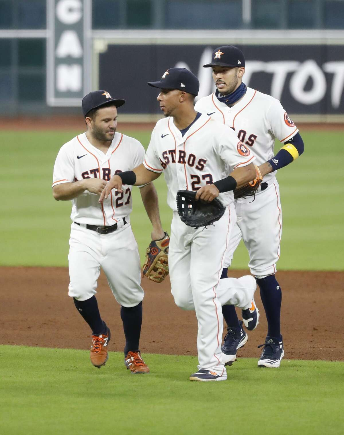 Houston Astros Michael Brantley (23) and Jose Altuve (27) celebrate the Astros 3-2 win over the Arizona Diamondbacks after the ninth inning of an MLB baseball game at Minute Maid Park, Saturday, September 19, 2020, in Houston.