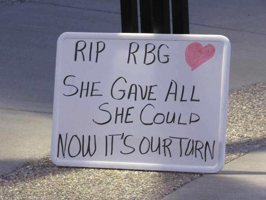 A sign honoring the late Ruth Bader Ginsburg stands on display.The vigil, which drew 40-50 people, took place Saturday evening in front of the Midland County Courthouse in downtown Midland. Photo: Victoria Ritter/vritter@mdn.net