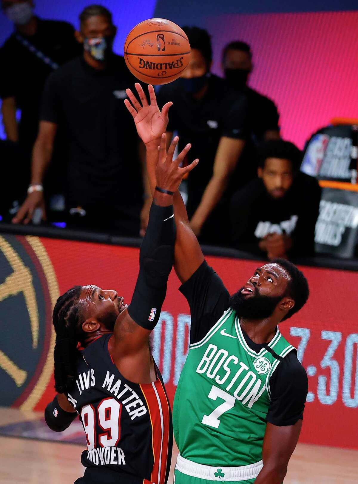 LAKE BUENA VISTA, FLORIDA - SEPTEMBER 19: Jae Crowder #99 of the Miami Heat and Jaylen Brown #7 of the Boston Celtics fight for a jump ball during the first quarter in Game Three of the Eastern Conference Finals during the 2020 NBA Playoffs at AdventHealth Arena at the ESPN Wide World Of Sports Complex on September 19, 2020 in Lake Buena Vista, Florida. NOTE TO USER: User expressly acknowledges and agrees that, by downloading and or using this photograph, User is consenting to the terms and conditions of the Getty Images License Agreement. (Photo by Kevin C. Cox/Getty Images)