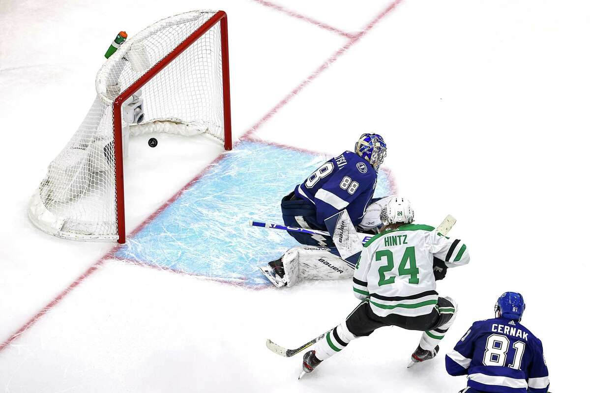 EDMONTON, ALBERTA - SEPTEMBER 19: Roope Hintz #24 of the Dallas Stars watches a goal go past Andrei Vasilevskiy #88 of the Tampa Bay Lightning by teammate Joel Kiviranta (not pictured) during the second period in Game One of the 2020 NHL Stanley Cup Final at Rogers Place on September 19, 2020 in Edmonton, Alberta, Canada. (Photo by Bruce Bennett/Getty Images)