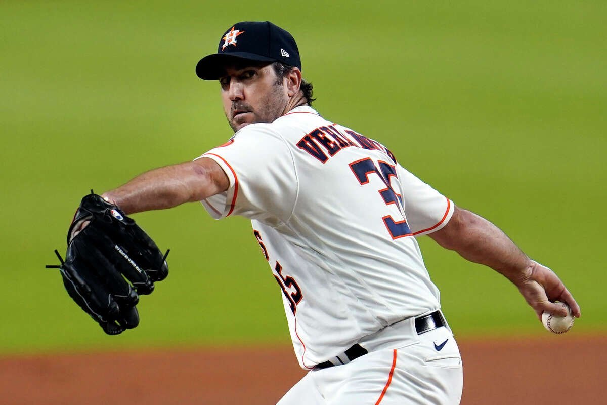 FILE- In this July 24, 2020, file photo, Houston Astros starting pitcher Justin Verlander throws against the Seattle Mariners during the first inning of a baseball game in Houston. The Astros announced Saturday, Sept. 19, 2020, that Verlander needs Tommy John surgery and could miss the entire 2021 season. (AP Photo/David J. Phillip, File)