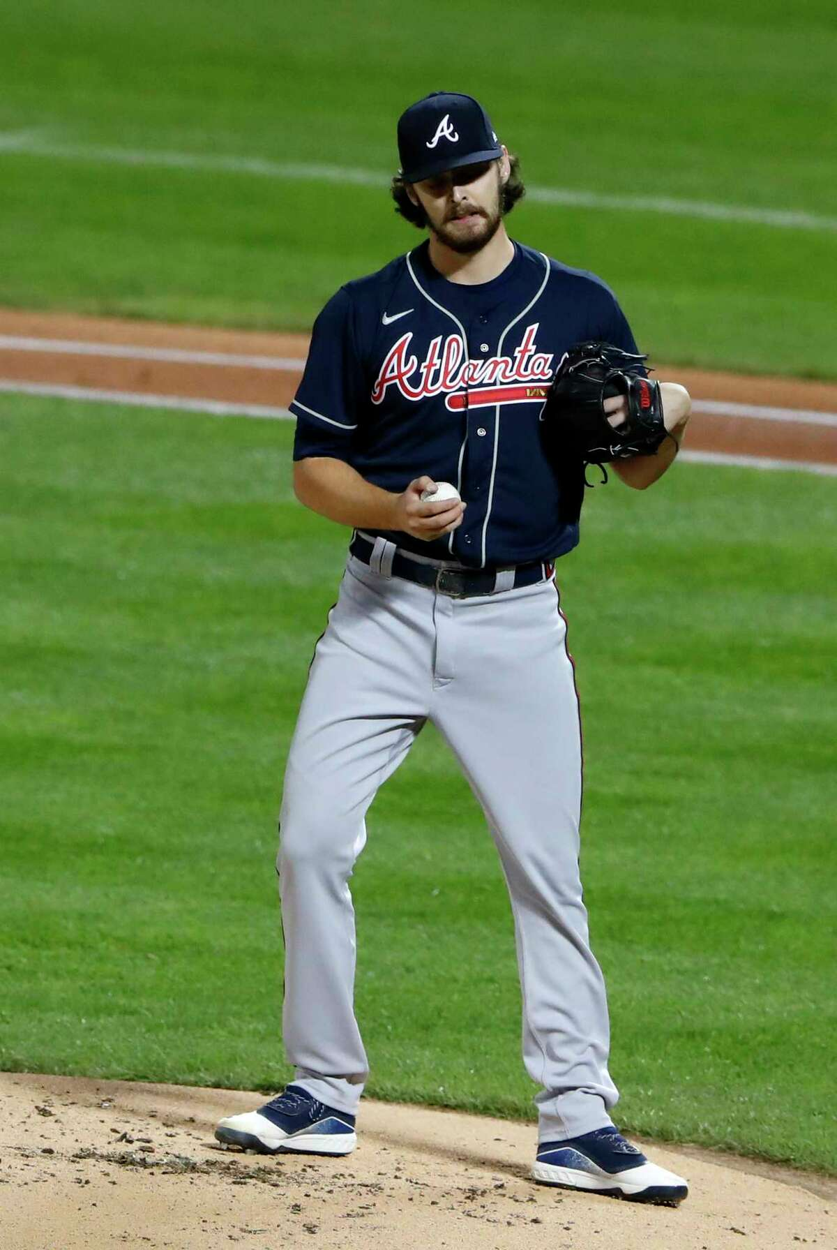 Atlanta Braves starting pitcher Ian Anderson pauses after loading the bases with three walks in the first inning against the New York Mets in a baseball game Saturday, Sept. 19, 2020, in New York. (AP Photo/Noah K. Murray)