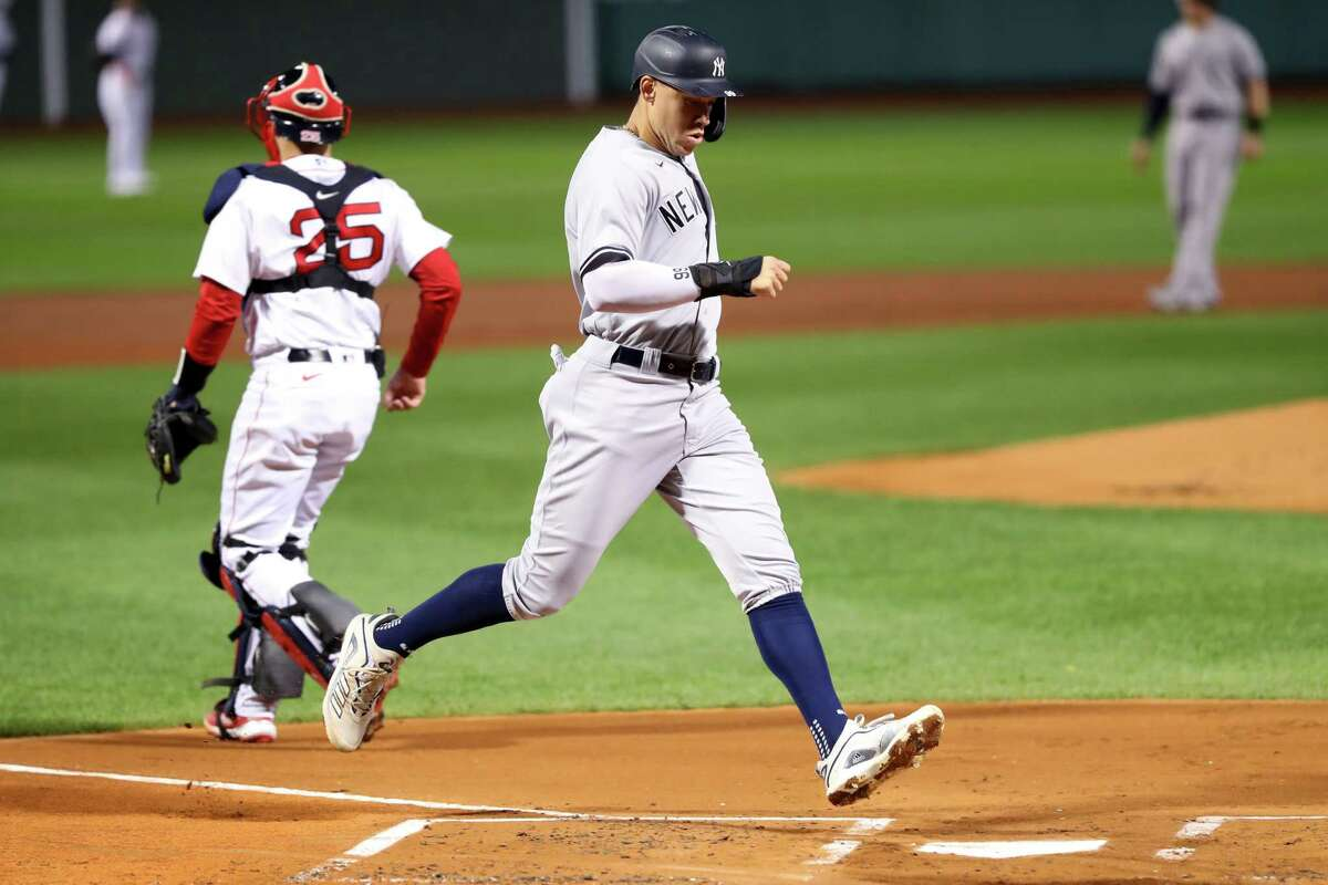 BOSTON, MASSACHUSETTS - SEPTEMBER 19: Aaron Judge #99 of the New York Yankees scores a run against the Boston Red Sox during the first inning at Fenway Park on September 19, 2020 in Boston, Massachusetts. (Photo by Maddie Meyer/Getty Images)