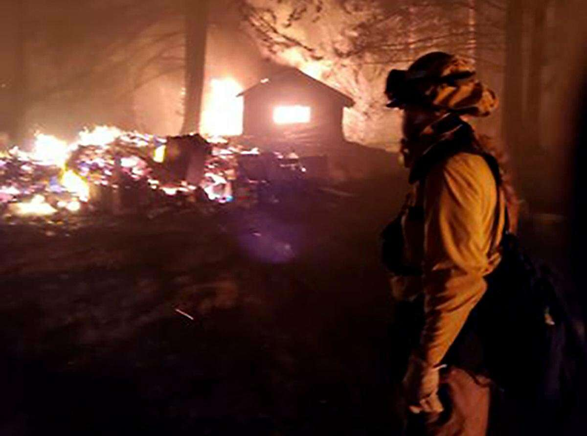 Firefighters work through the night to save structures at Breitenbush Hot Springs in Oregon. (Courtesy photos Breitenbush Hot Springs/TNS)