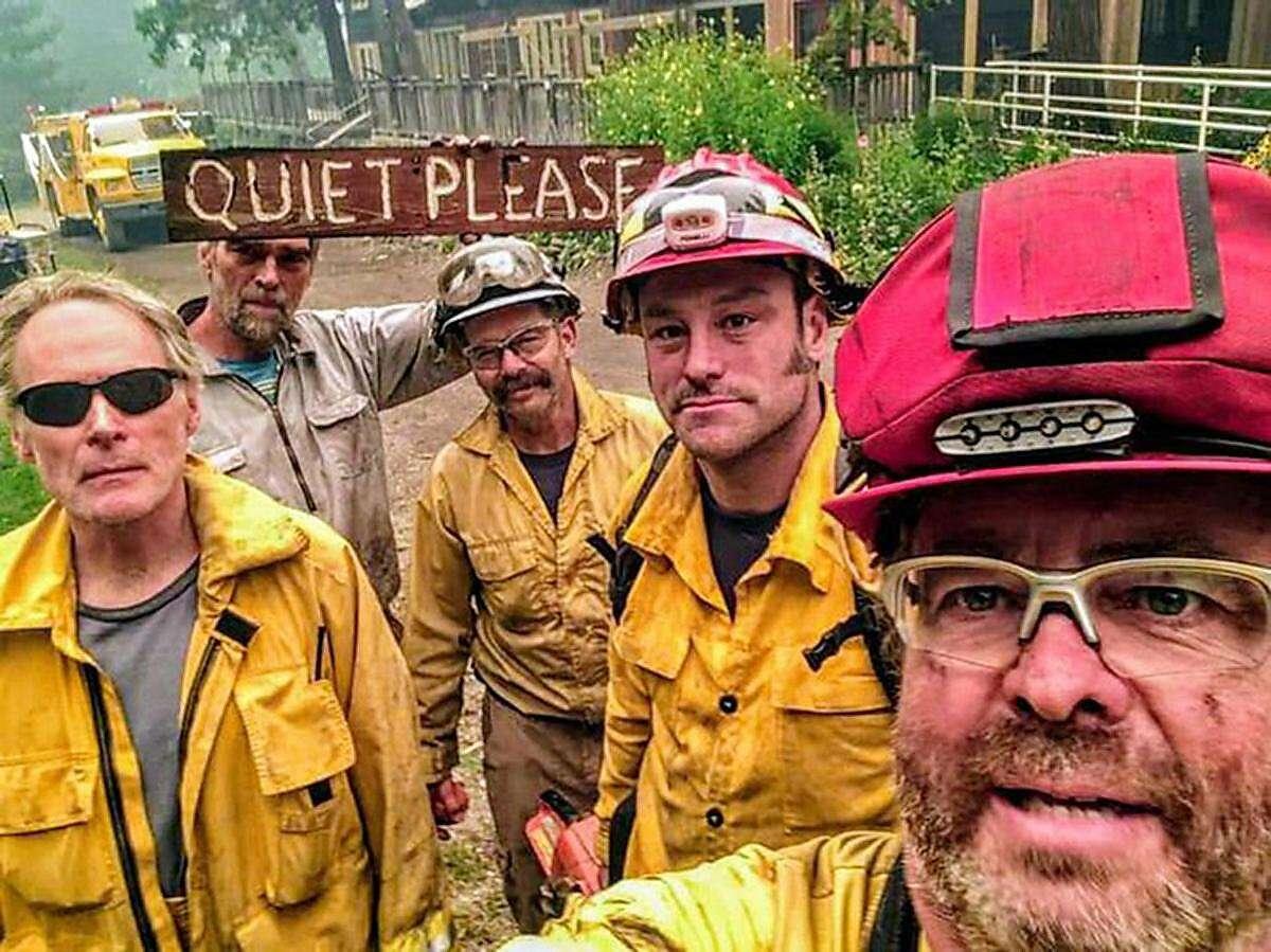 Five firefighters work to save structures at Breitenbush Hot Springs in Oregon. They are, from left, Tim McDevitt, Daniel Dundon, Jordan Pollack, Neil Clasen and Erik Wennstrom. (Courtesy photos Breitenbush Hot Springs/TNS)