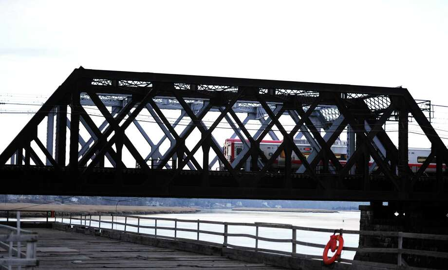 A Metro-North train passes over the Housatonic River on the Devon Railroad Bridge Tuesday, Jan. 20, 2015 between Stratford and Milford. Photo: Autumn Driscoll / Connecticut Post / Connecticut Post