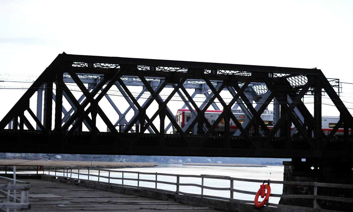 A Metro-North train passes over the Housatonic River on the Devon Railroad Bridge Tuesday, Jan. 20, 2015 between Stratford and Milford.