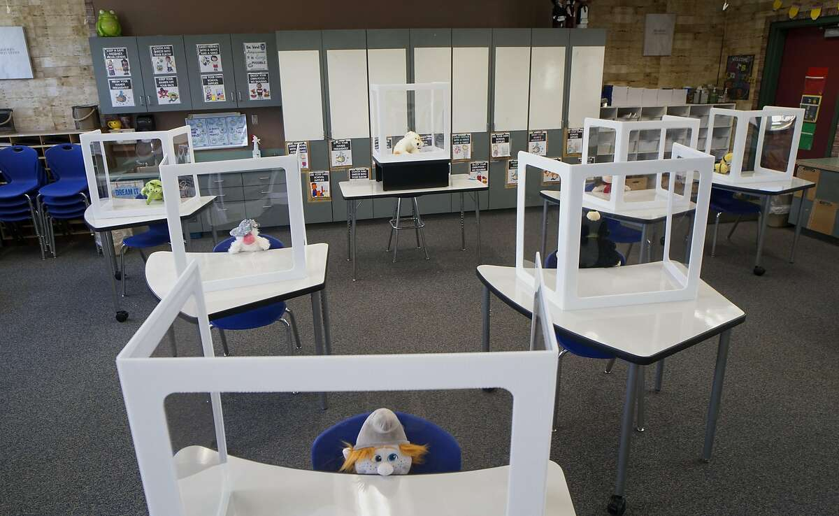 Plexiglass shields sit on desks in an elementary school classroom in El Cajon, Calif., on Thursday, Aug. 27, 2020. Cajon Valley in California is doing something that many lower-income districts have postponed: offering in-person instruction. (Sandy Huffaker/The New York Times)