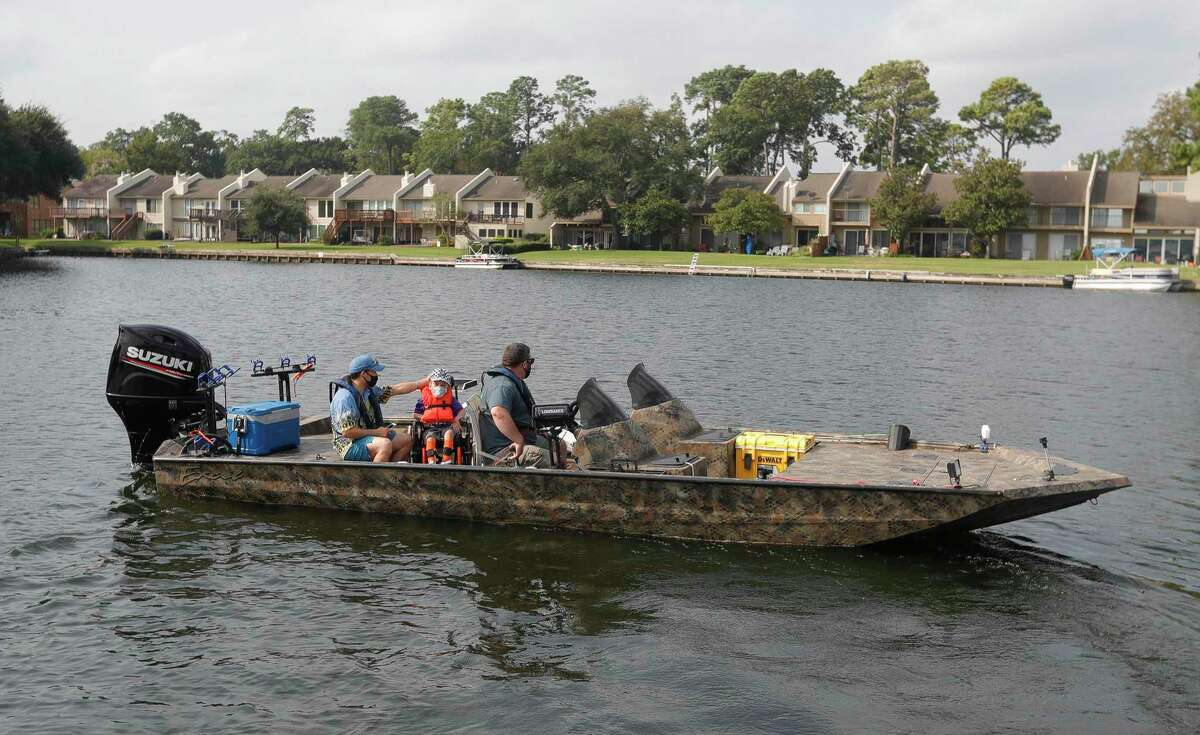 John Adams drives a boat as he takes Tanner Hicks, 10, and dad, Tristian, out fishing during Casting for Casey, a free event for families with special needs children, Saturday, Sept. 19, 2020, in Montgomery. The event gave children the opportunity to go fishing with anglers on Lake Conroe.