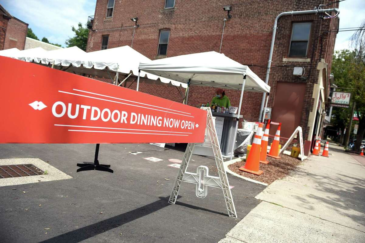 The parking lot of Sally's Apizza on Wooster Street in New Haven has been converted into a dining area.