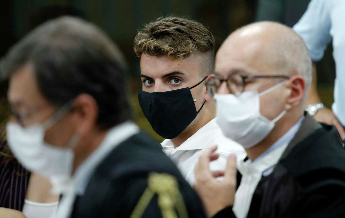 Gabriel Natale-Hjorth, from California, center, sits during a break in the hearing in his trial where he and his friend Finnegan Lee Elder are accused of slaying a plainclothes Carabinieri officer while on vacation in Italy last summer, in Rome, Wednesday, Sept. 16, 2020. (Remo Casilli/Pool Photo via AP)