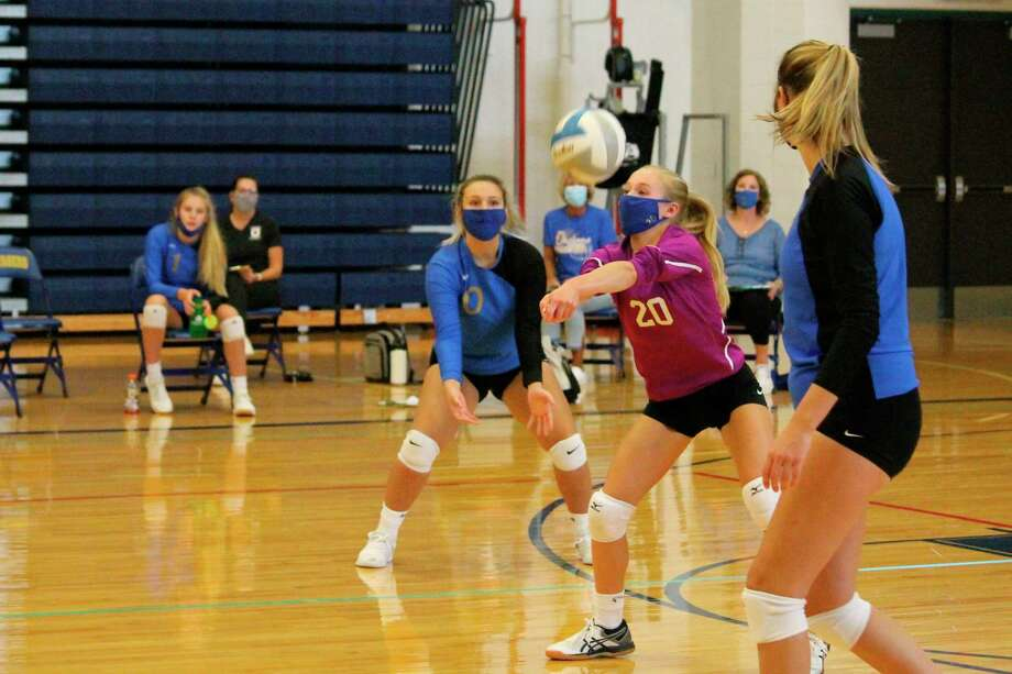 Onekama libero Madison Gutowski comes up to field a serve during the Portagers' home tri-match on Saturday. (Photo/Robert Myers)