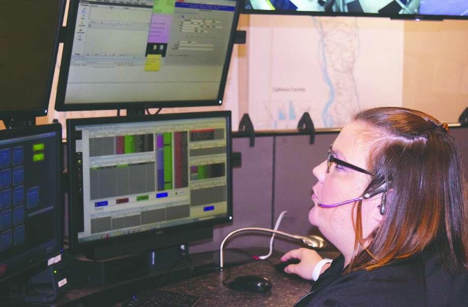West Central Joint Dispatch Center dispatcher Sarah Rushton handles a call for assistance. Photo: Samantha McDaniel-Ogletree | Journal-Courier