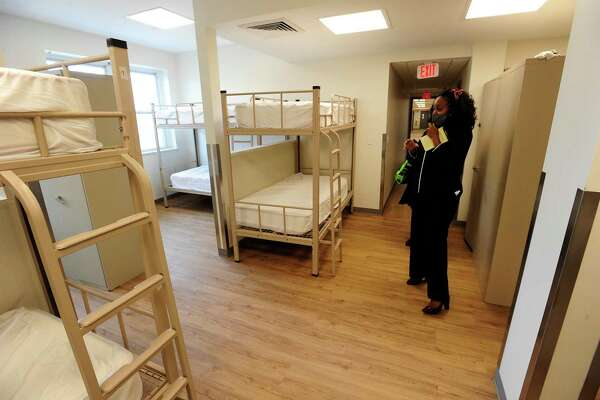 Elsi Lyons, Director of Development and Event for Pacific House leads a tour, showing off a newly renovated room for clients of Pacific House on Sept. 16, 2020 in Stamford, Connecticut.